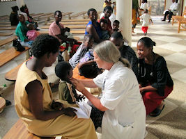 doctor malawi hospital tending family