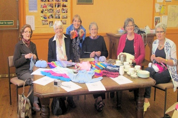 Knitting tiny hats and clothes for premature babies
